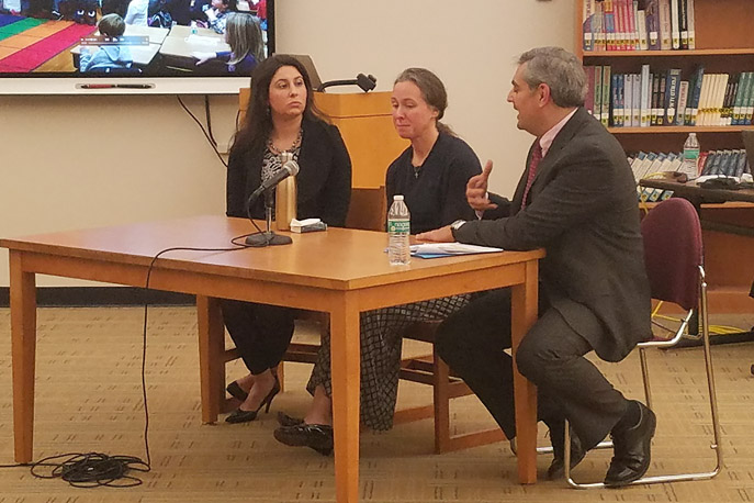 Lauren Gobbo, Fran Corelli and Dr. Steven Garcia sit at a table in the Middle School Library.