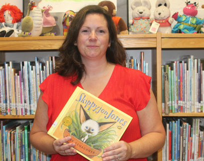 Mrs. Hand is KES' new librarian.