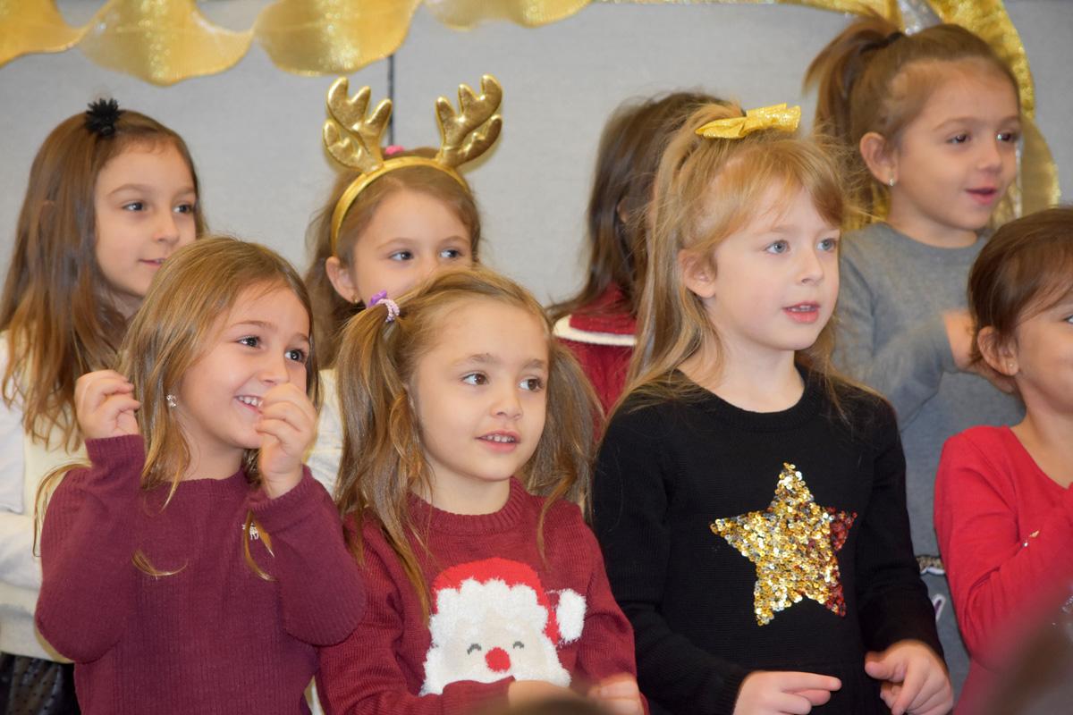 Kindergarteners perform in holiday concert.